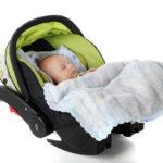 Baby in baby capsule restraint